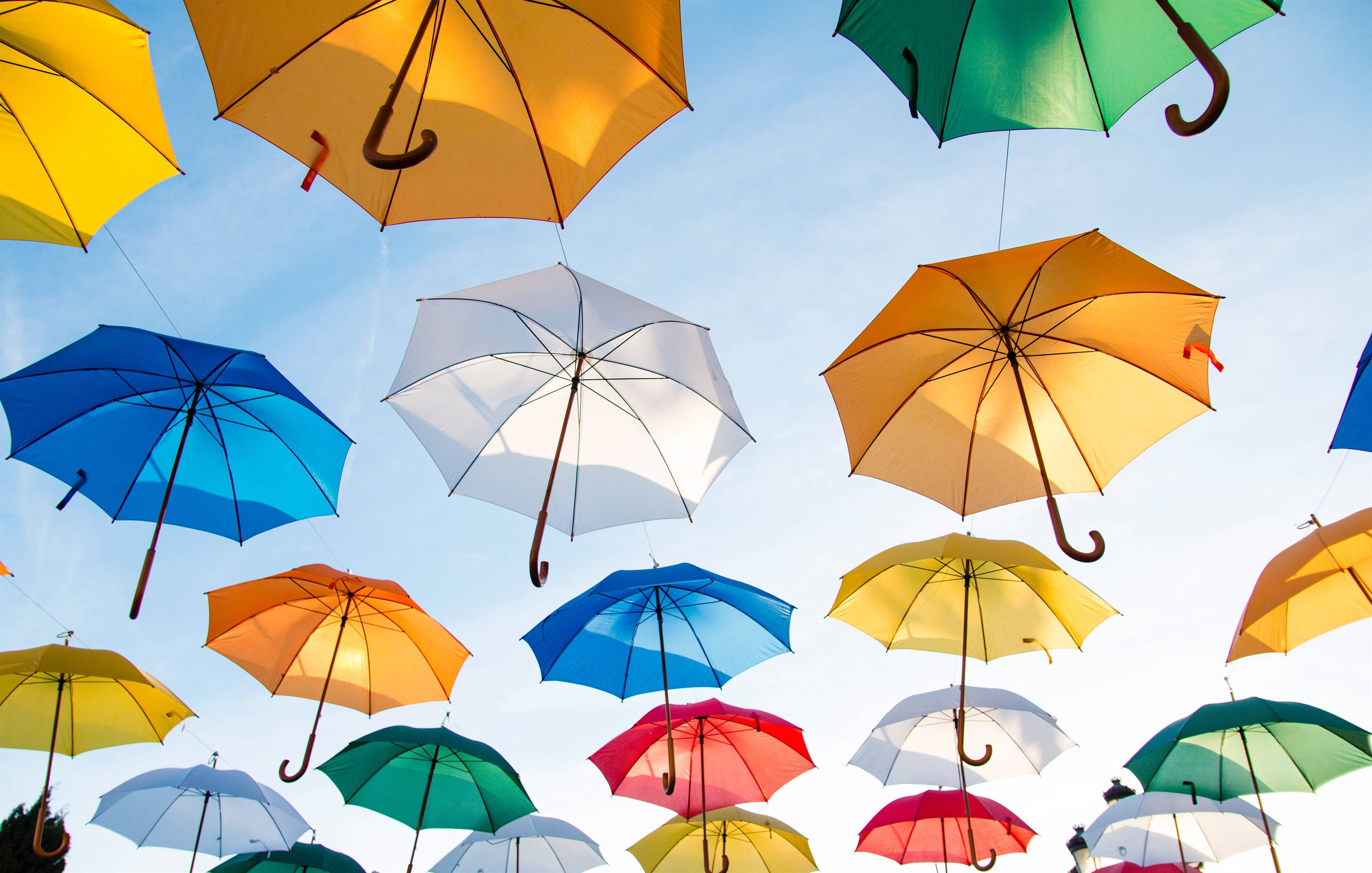 umbrellas hanging in sky