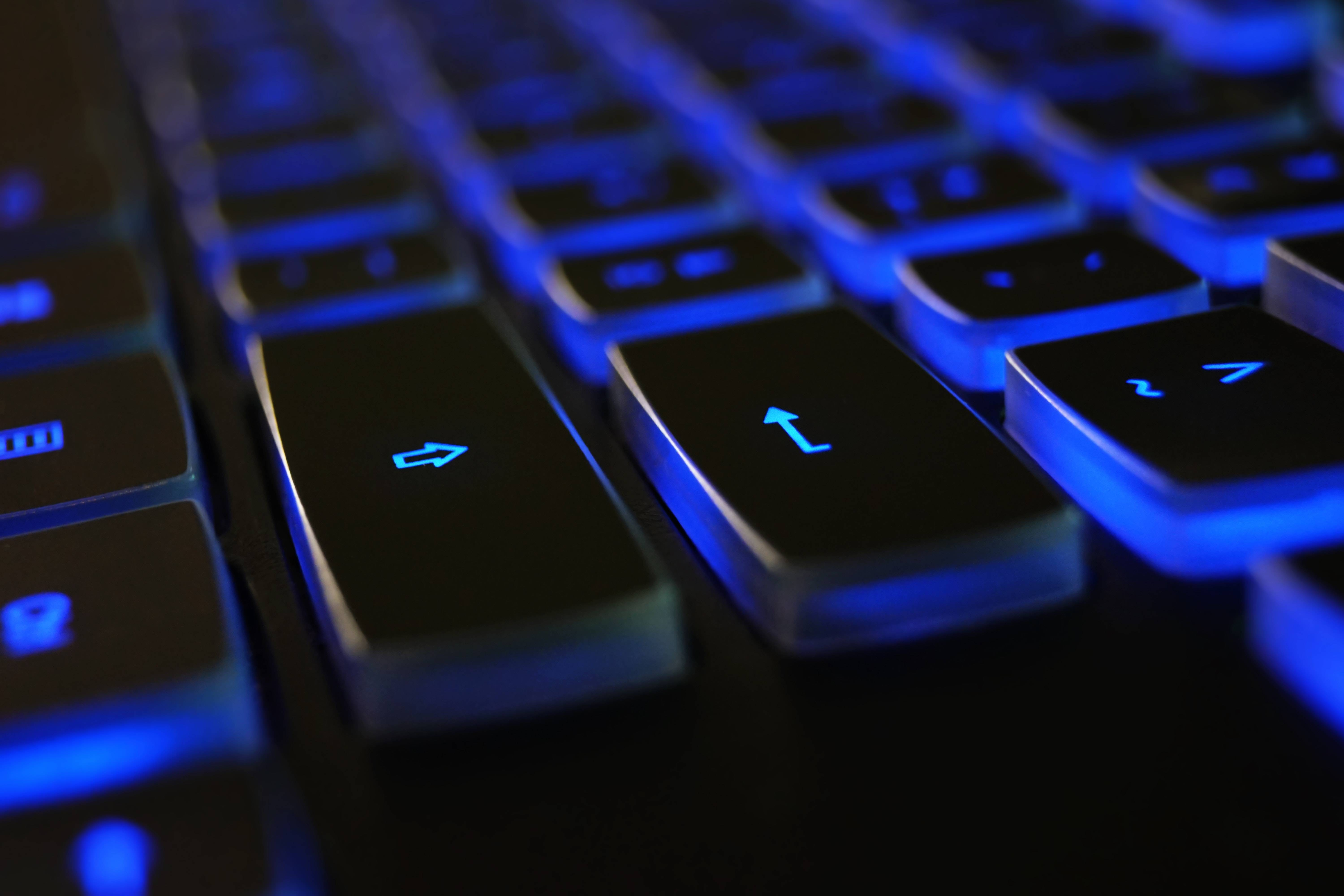 glowing keyboard - shield companies from cybercrime