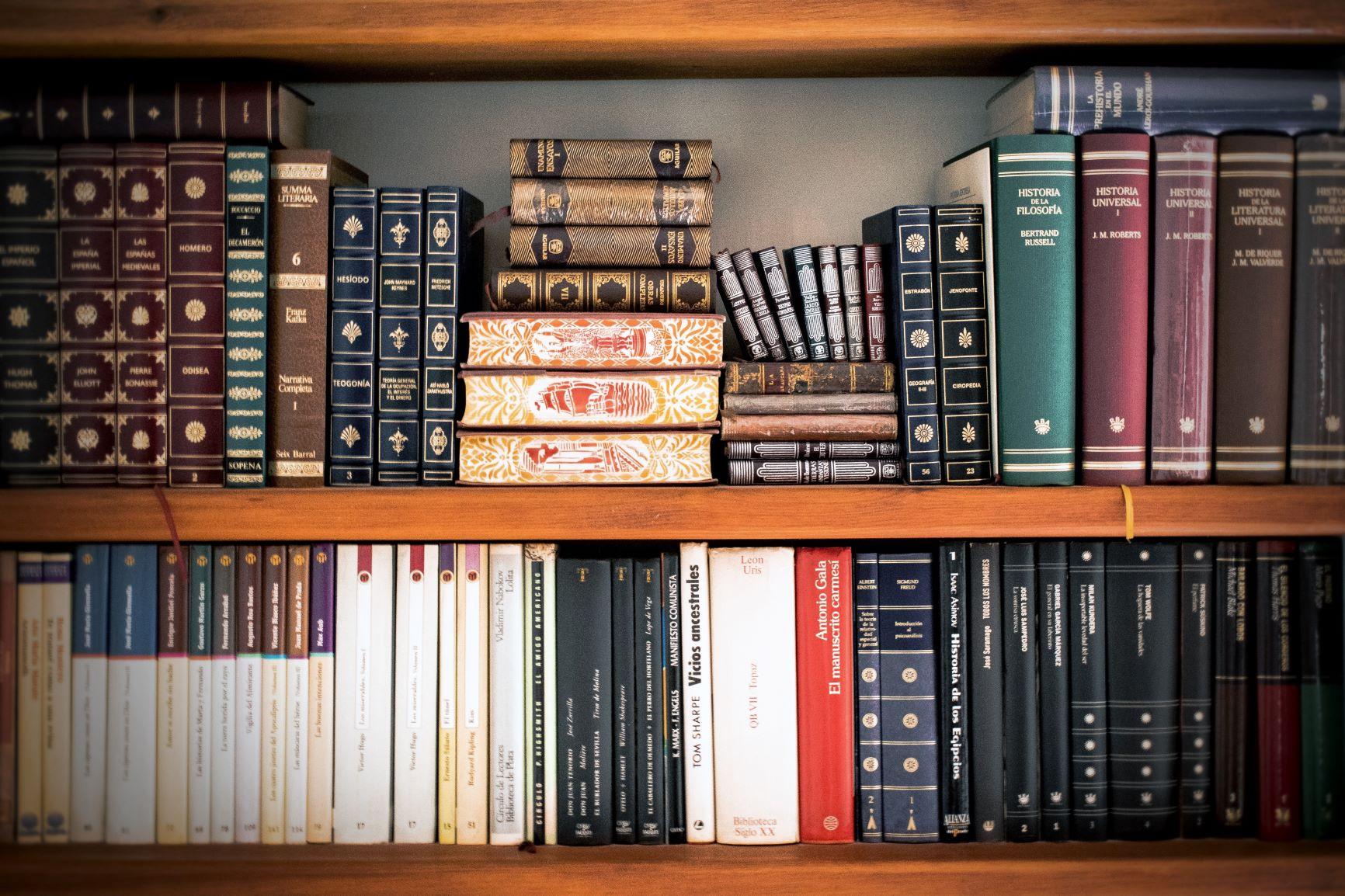 full bookshelf - stacked books.