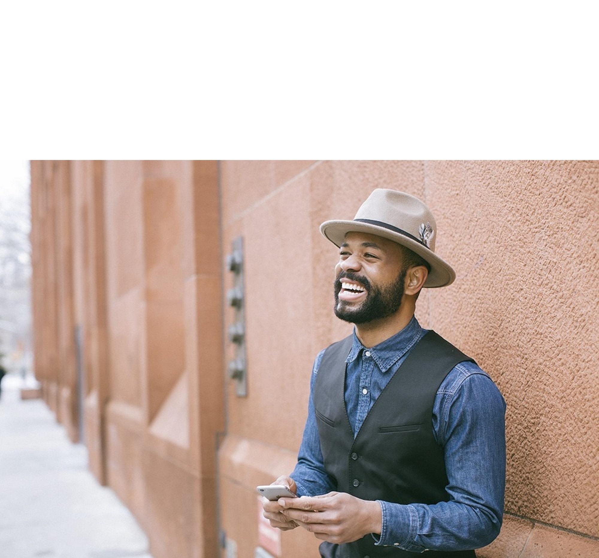 smiling man in hat